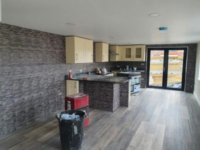 Kitchen and living room taking shape with laminate floor